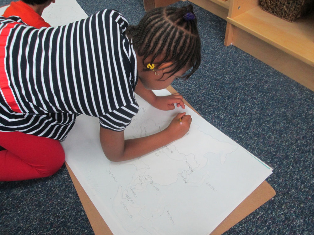 The Lower Elementary East students continued to study Asia. They conducted research, created maps, gave presentations, worked with materials and chose related Practical Life activities from the shelf.  A first grade student diligently worked on her map of Asia.