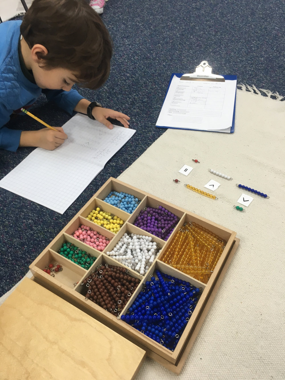 "First grade Lower Elementary West students used Math Beads to work on a follow up for the ""greater than, less than"" Math lesson."
