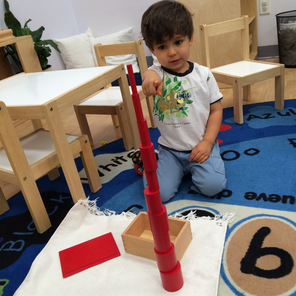 A Toddler 1 student used a delicate touch to build a tower.