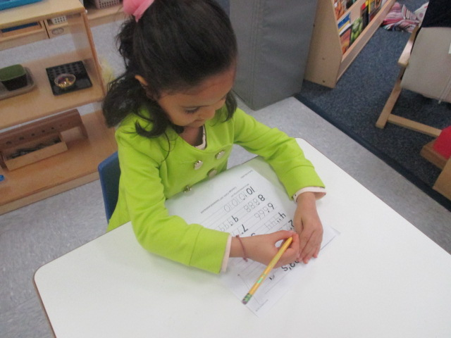 Primary 1 students practiced their pencil grips and writing by tracing letters and numbers.