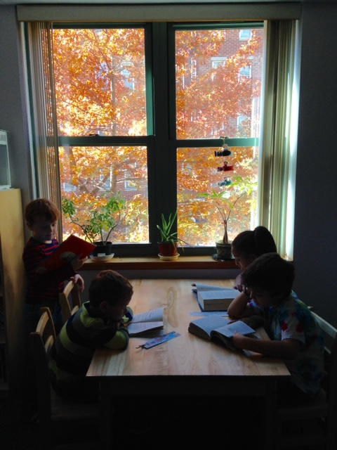 Lower Elementary West students took a moment for silent reading while enjoying the lovely view of fall right outside their window.
