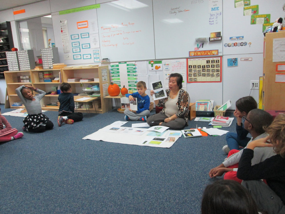 Ms. Maris shared a presentation about The Philippines with the Lower Elementary East class. The students learned Filipino phrases and information about customs, money, government, traditions and geographical terms of the country. A Lower Elementary East students who is studying the country helped Ms. Maris with her presentation.