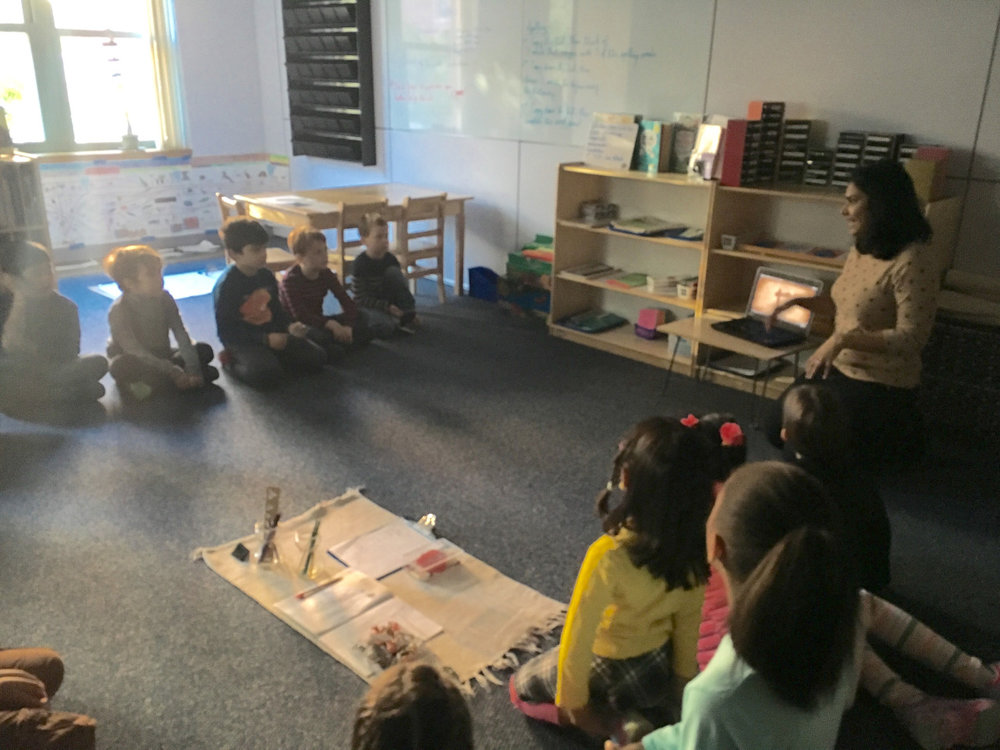A Lower Elementary West parent visited the class to share a presentation about the Indian festival of Navrati, which celebrates the goddess Durga.