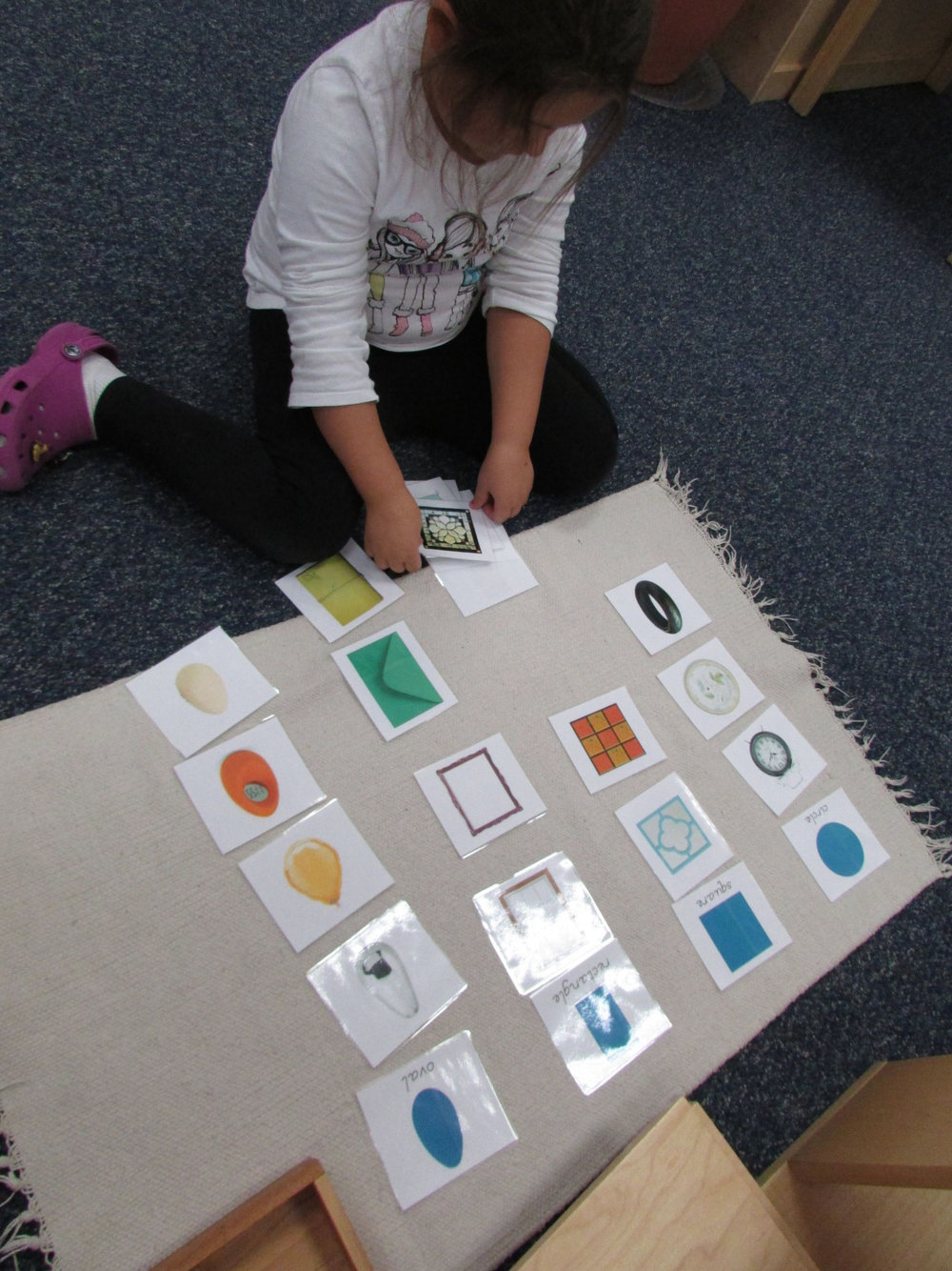 A new work in the Primary 3 class is aimed at developing observational skills. It requires observing shapes and categorizing them with other pictures with similar shapes.  Knowledge of the geometric shapes is important to support early mathematical skills.