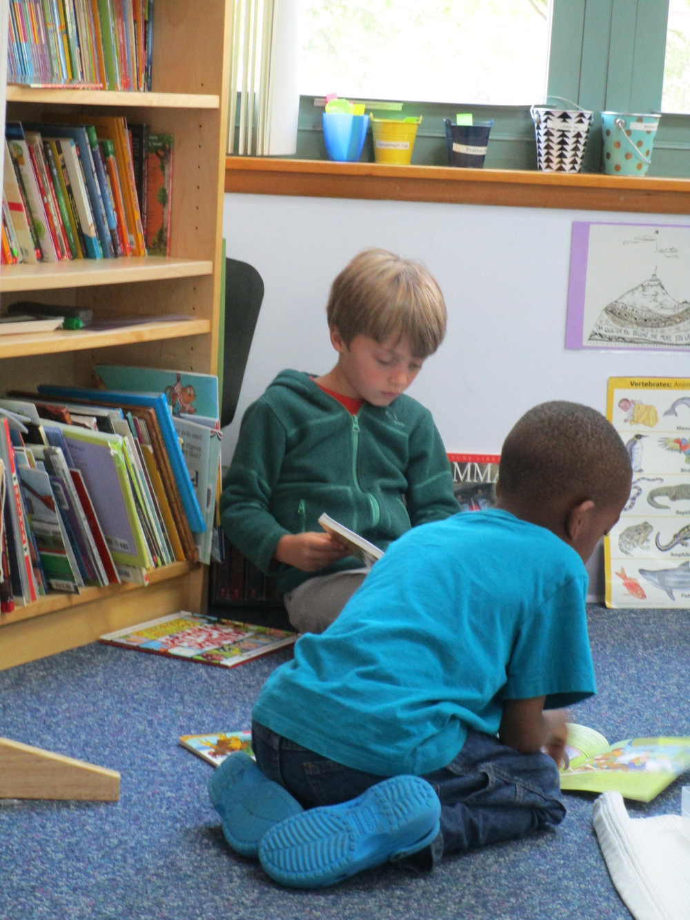 Two first grade Lower Elementary West students enjoyed silent reading time after lunch.