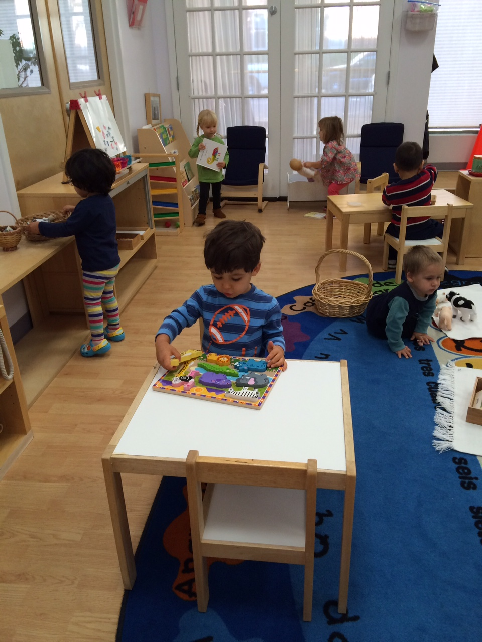 "The Toddler 1 students choose and become absorbed in what each of them is curious to master.  In Montessori, we call this their ""work""."
