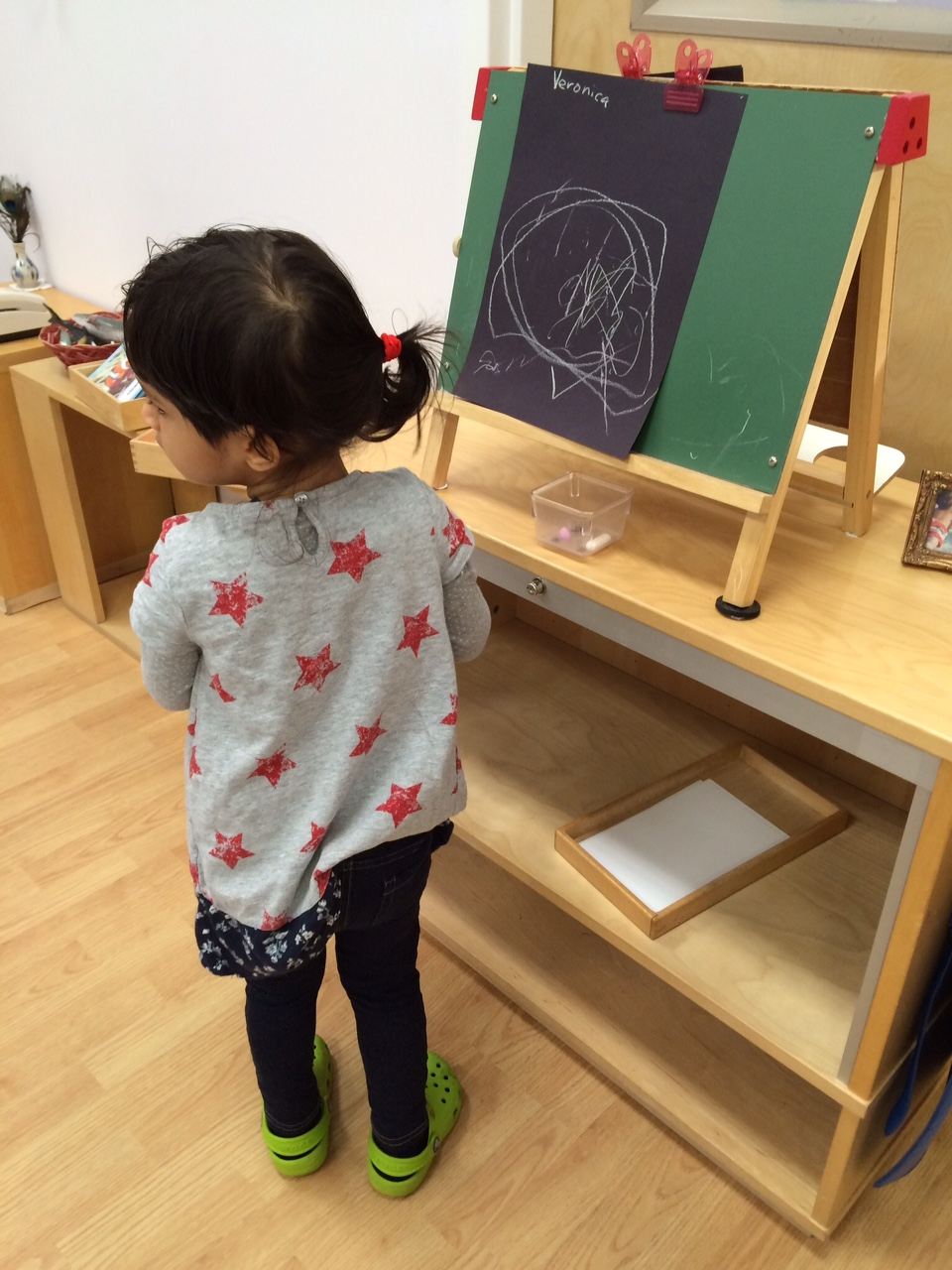 A Toddler 1 student drew circular lines, which is the beginning of cursive writing.