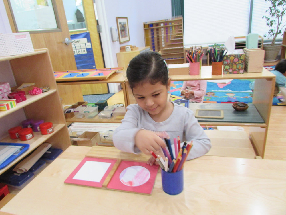 A Primary 2 student used the Metal Insets to help prepare her pencil grip for writing.