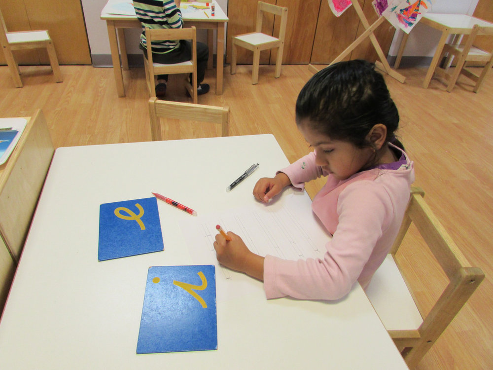 A Primary 2 four-year-old student practiced cursive writing.
