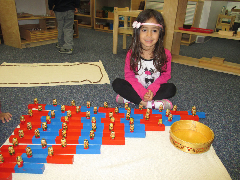 A Primary 1 student used the Number Rods in a new way, counting little Matryoshka dolls along with the rods.