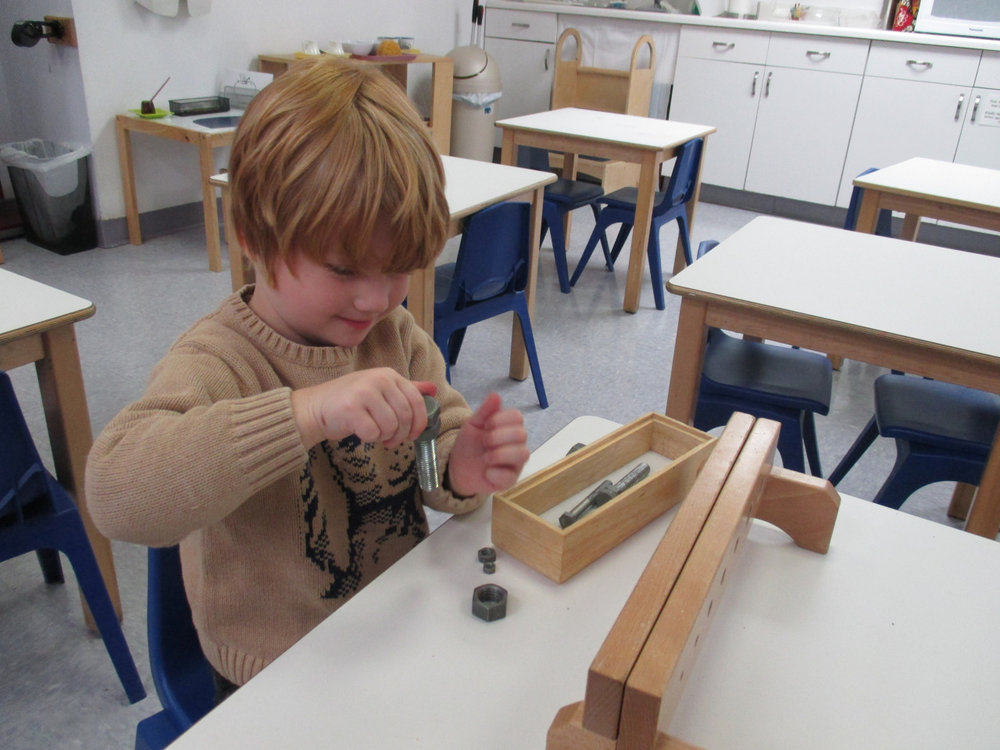 A Primary 1 student refined his fine motor skills by working with nuts and bolts. This activity specifically helps students to be able to use the twisting hand motion required to open and close bottles or sharpen pencils.