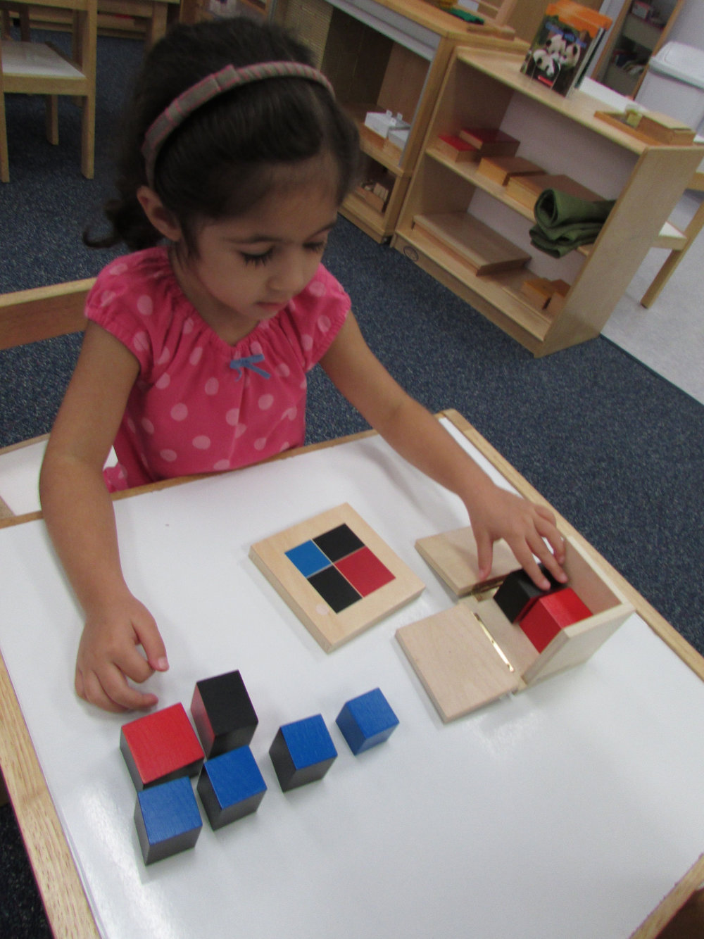 The Binomial Cube is a Sensorial work that introduces abstract Math concepts to the Primary 3 students. The early sensorial experience with the cube inspires them again later when they use the cube for Algebra during the Elementary years.