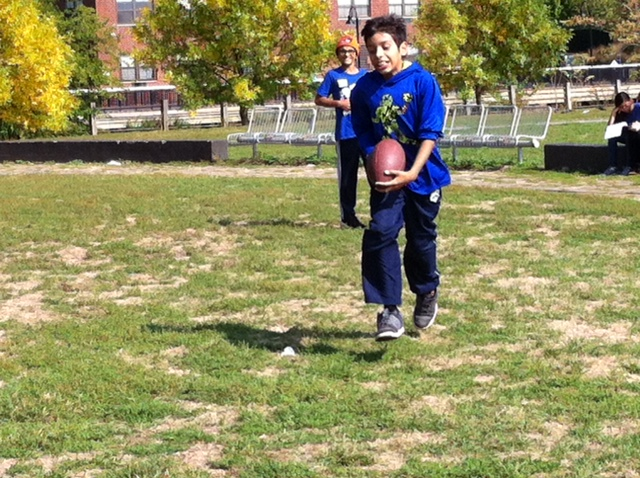 A friendly game of football is a popular Middle School recess activity.