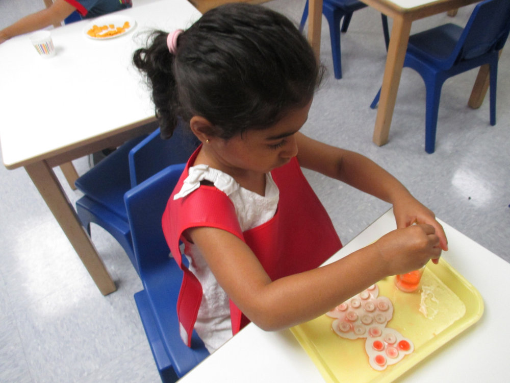 Using an Eye Dropper is a Practical Life work that exercises fine motor skills and helps to develop concentration. A Primary 1 student was completely focused on her eye dropper activity.