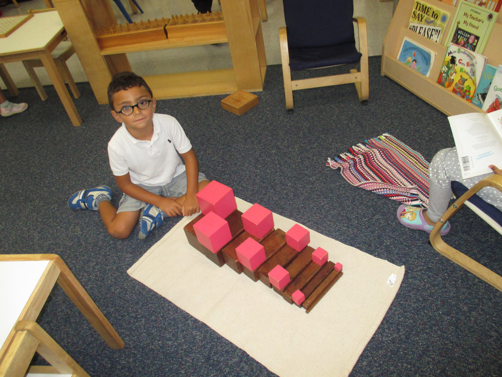 Once Primary 1 students master their skills with certain materials, they explore by trying their own extensions. One student chose to create his own extension using both the Pink Tower and the Brown Stairs.