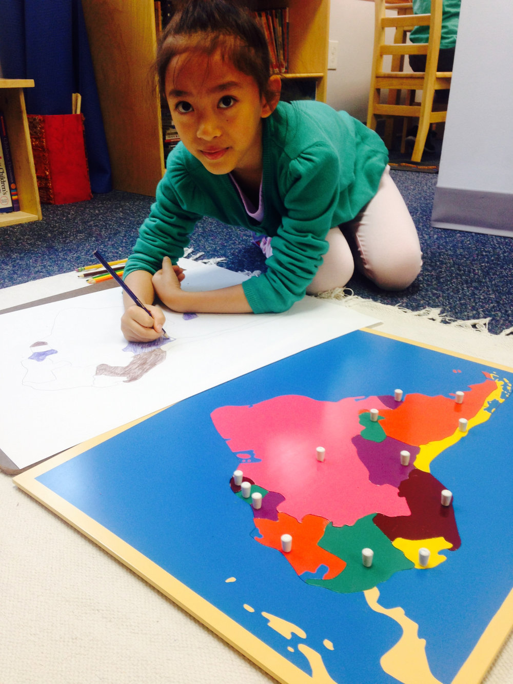 Map making is a popular work in the Lower Elementary West classroom.  The students trace, color and finally label all parts of the Continent.