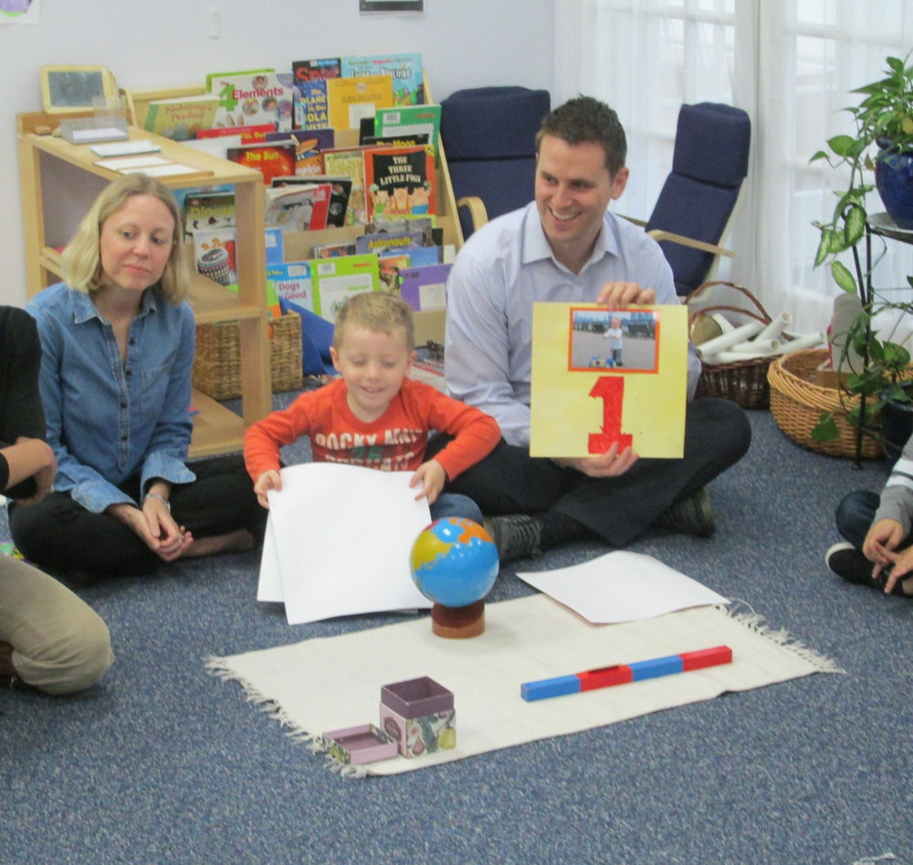 A younger Primary 3 friend was excited to have his parents visit to celebrate his birthday. In typical Montessori fashion, he took a walk around the Sun and shared pictures from each year of his life. Finally, his parents read one of his favorite stories to his classmates.