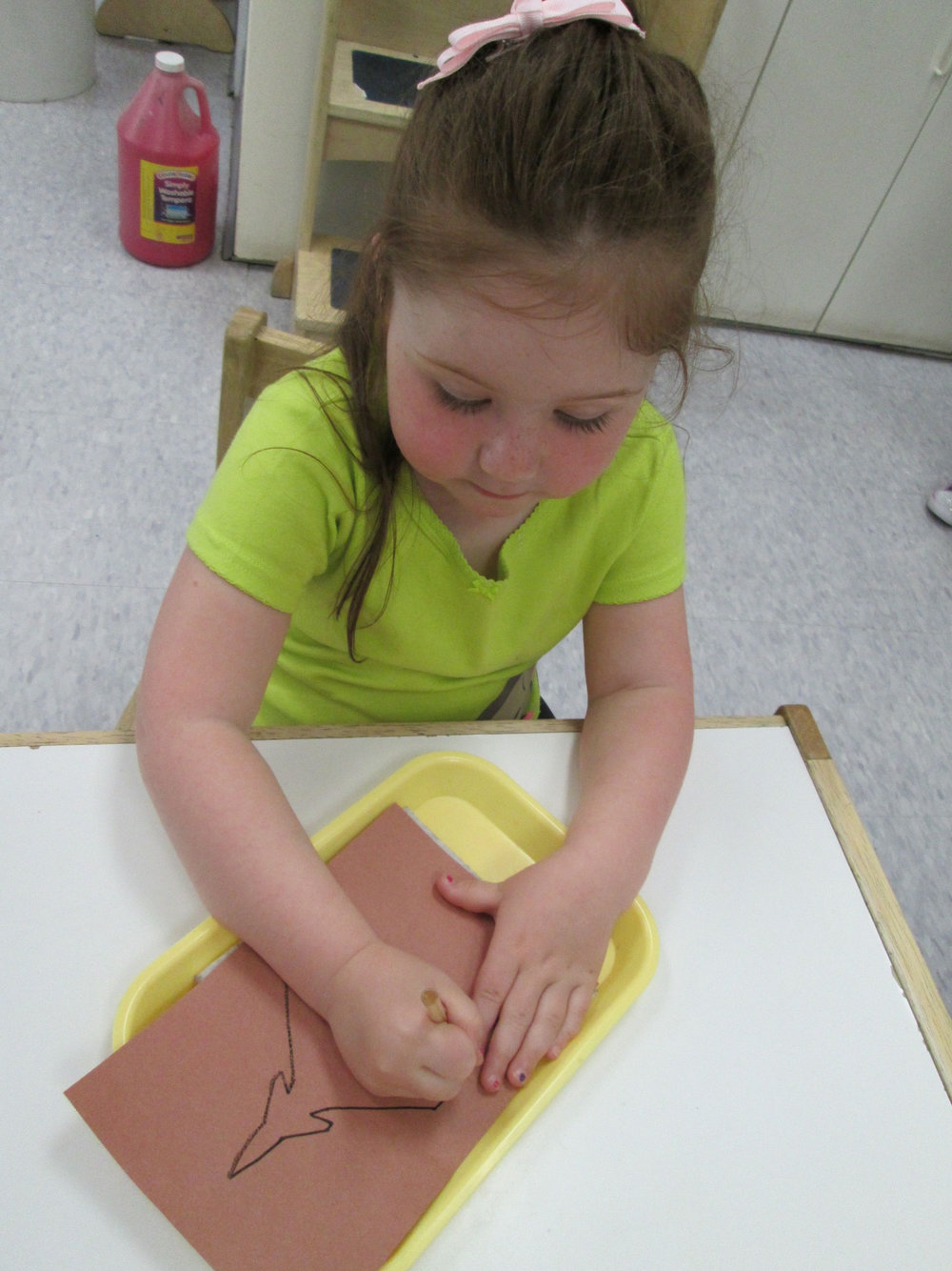 In the Practical Life area, pushpin work is popular. It requires concentration and helps students to develop their fine motor skills.