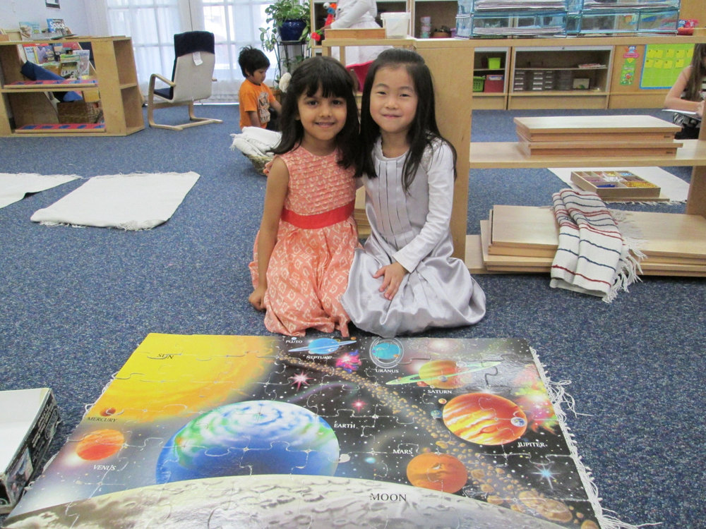 As part of their studies about the solar system, the Primary 3 students love to work on large solar system floor puzzles together.