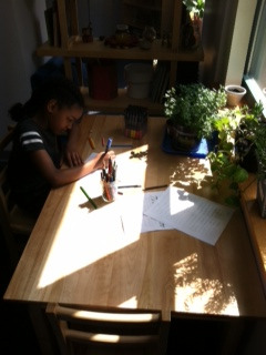 A Lower Elementary West student completed her Junior Great Books writing assignment in the afternoon sunlight.