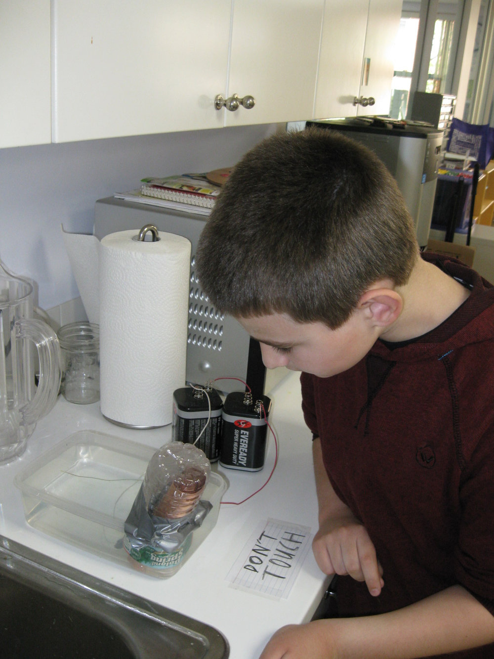 One Middle School student split water to produce hydrogen and oxygen in a Hoffman apparatus.