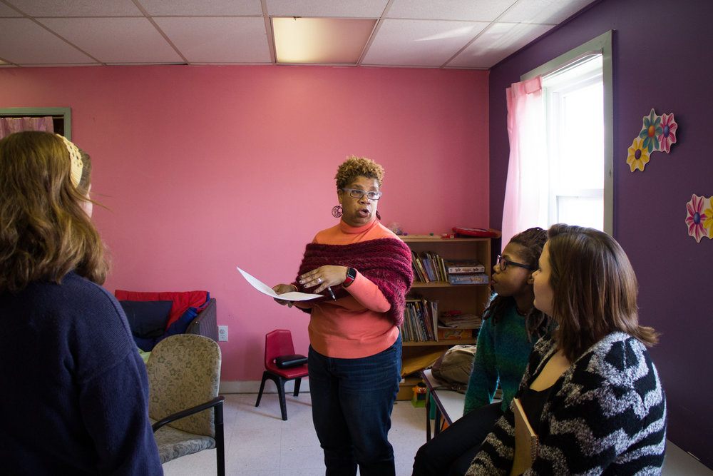 Lead organizer Lisa Nelson-Haynes talks with student volunteers during The Redline Project workshop at The Dixon House in the Point Breeze January 16, 2016.