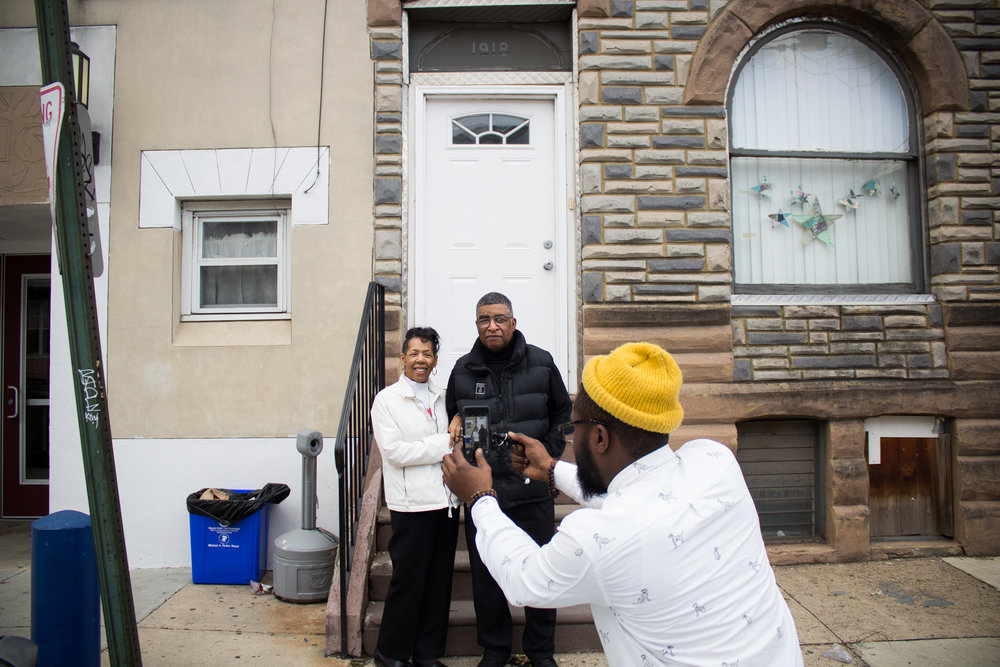 "Visual Documentarian Donnell Powell takes a photo of Alice and Beresford Gabbadon during The Redline Project workshop at The Dixon House in Point Breeze January 16, 2016.  ""I grew up in Point Breeze my whole life,"" said Alice. ""When I was a young girl, that's when I first started to see the drug problems come to life in Point Breeze. I could leave. I could move to the Main Line with my daughter, look down on all the cars buzzing by, but I don't want that. Even though there are drug and gang problems, I'm still here for my community and I love the people of Point Breeze."""