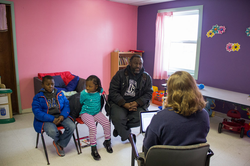 Al Custis, 42, is joined by his children Khabirah, 5, and Kheli, 9, as he shares his story during The Redline Project workshop at The Dixon House in Point Breeze January 16, 2016.
