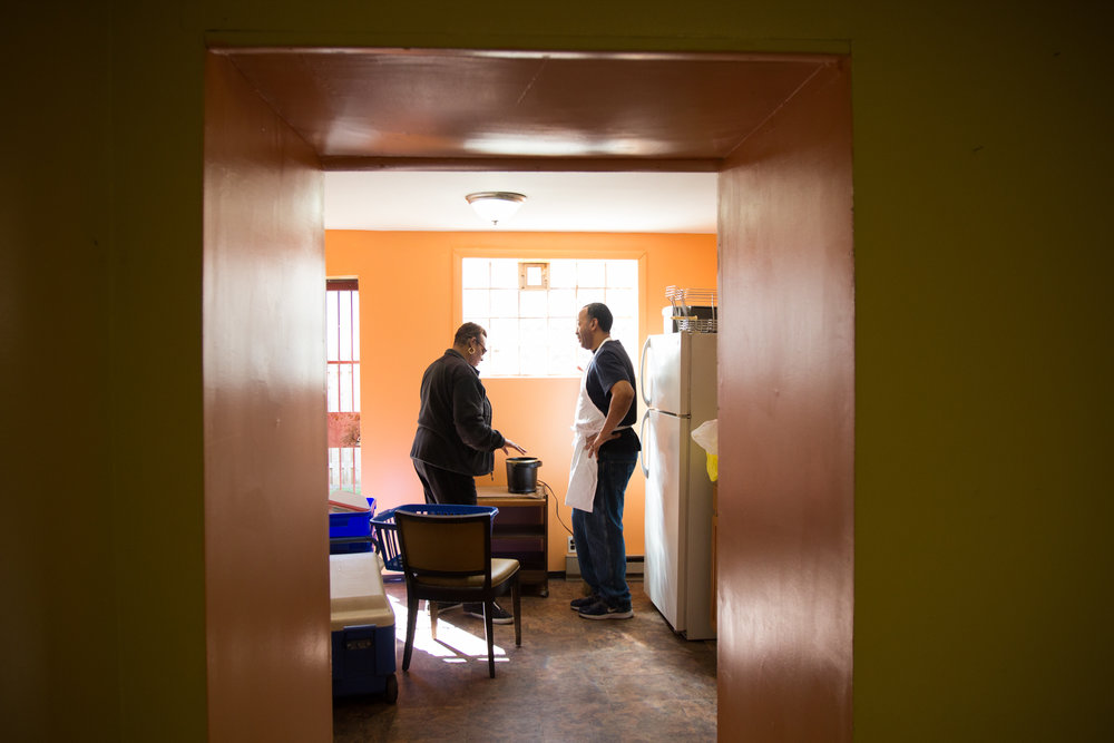 Helen Boggs and Michael Bell begin to prepare lunch during the third and final workshop of The Redline Project, held at the Neighbors in Action Association house in Point Breeze March 12, 2016.