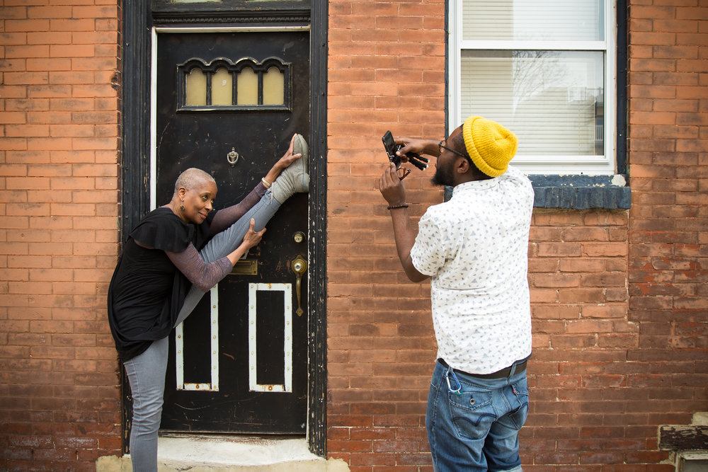 "Point Breeze resident Rhonda Moore poses for photos during the third and final workshop of The Redline Project on March 12, 2016. Moore teaches Ballroom dancing to elementary students in Philadelphia and is also a dance faculty member at Temple University.   ""Every element of the neighborhood is not the greatest, but that's every neighborhood. The block is a fairly united one. We participate in cleanups on my block and every house is involved to some degree."""