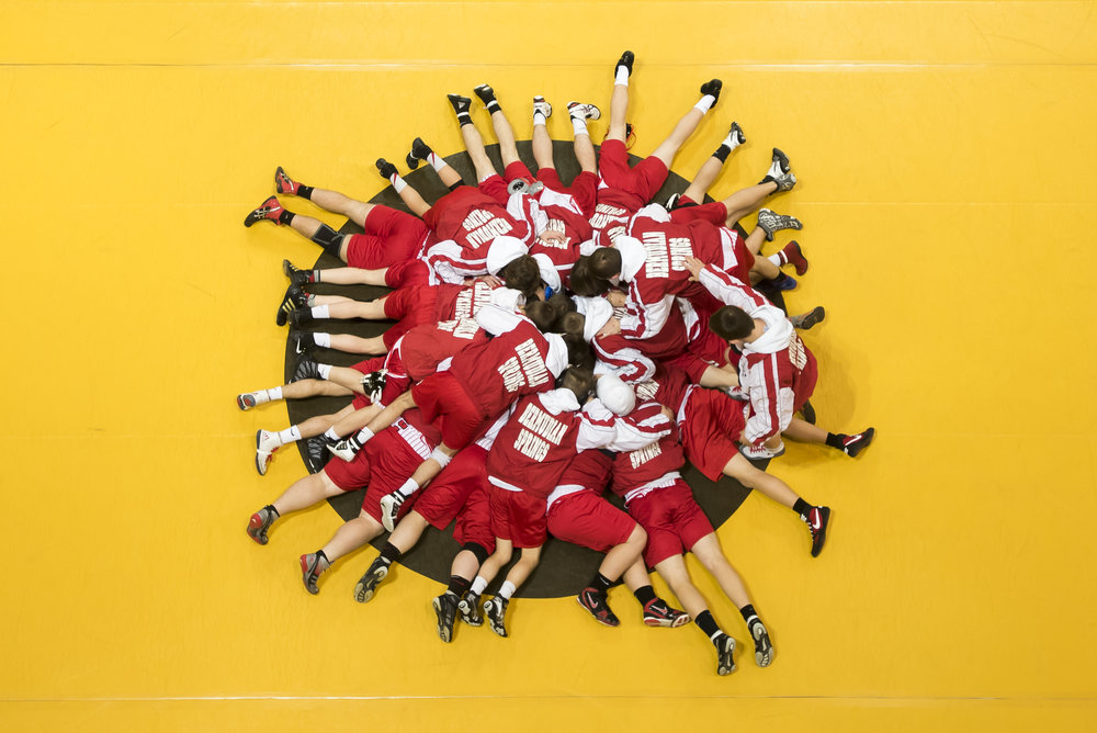 The Bermudian Springs High School wrestling team huddle up prior to their District 3 Class 2A Championship match against Bishop McDevitt at Milton Hershey School.