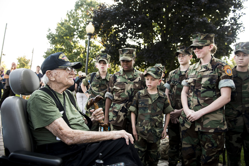 "Members of the Hanover Area Young Marines talk with Lawrence ""Gump"" Bolin, 94, who fought in the Army during World War II. Bolin served as a private first class and landed on the beaches of Normandy on D-Day plus 6."