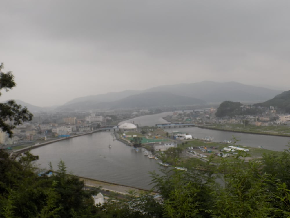 This is the view looking behind me when standing at the bay at Ishinomaki. The wall of water continued to plow through this part of the town and against the mountains.