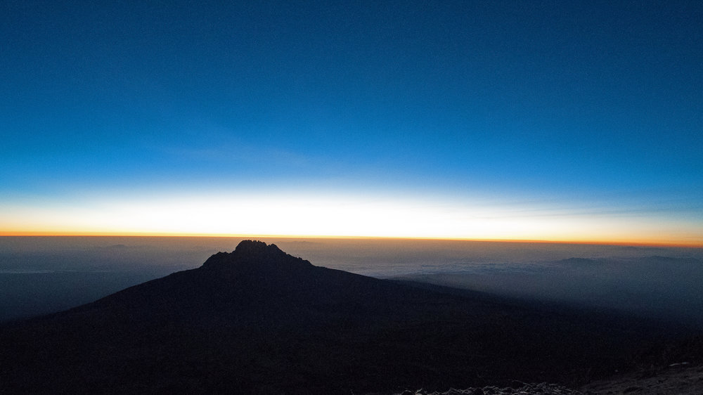 Sunrise on January 12, 2017. Kenya on the left, Tanzania on the right, Mawenzi in the middle.