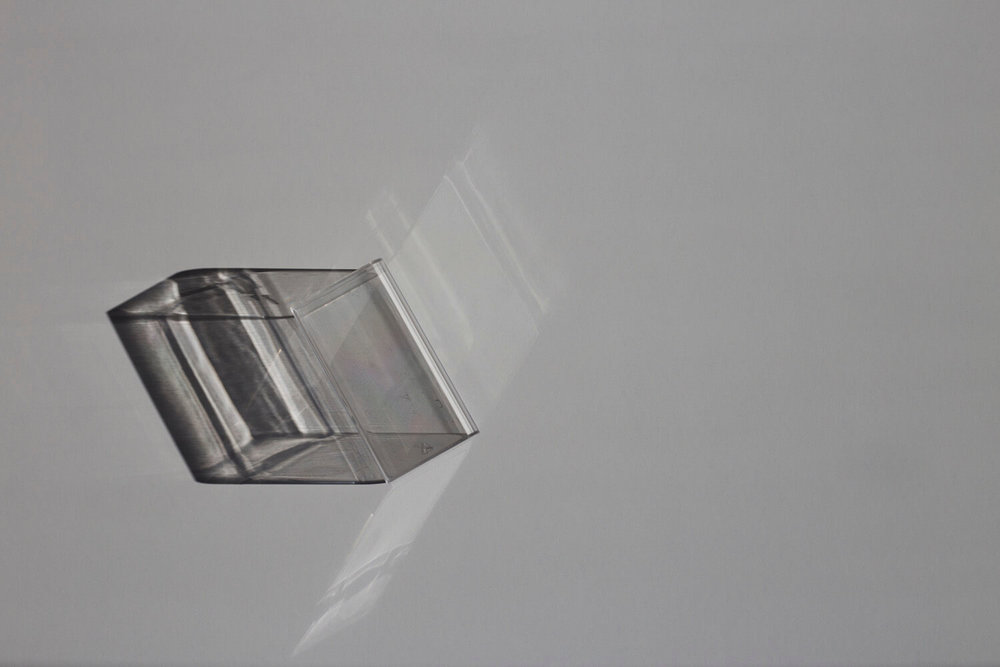 The Mundane re-examines objects that are made to be of use only once. I repurpose each object as a vessel for performance, manipulating the inner structure with sunlight and distorting our perceptions of the familiar object.This however, is a fragile existence lasting while light does.