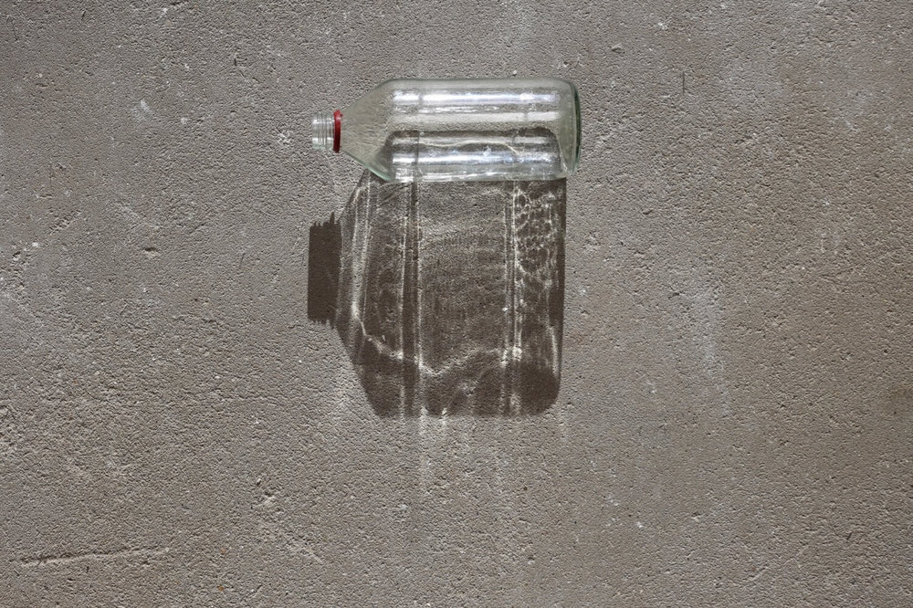 Bottle, concrete, shadow Mundane 2018