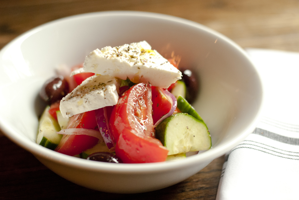 VILLAGE SALAD CUCUMBER, ORGANIC TOMATOES, CAPERS, OLIVE, RED ONION, FETA