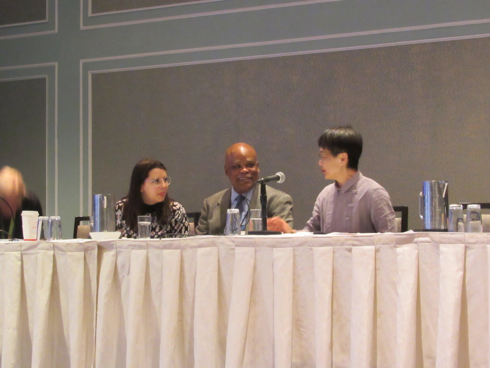 Laura Arike and Gil Gerald take a moment and chat with Panel Moderator, Amy Cheng, Professor at SUNY, New Paltz