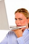 Business lady biting Laptop by Ambro
