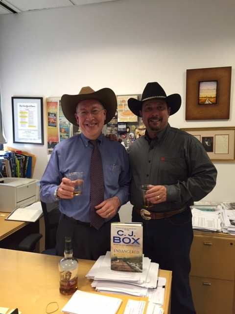 G.P.Putnam Editor-In-Chief Neil Nyren and CJB celebrate the news that ENDANGERED debuts at #2 on the New York Times Bestseller List