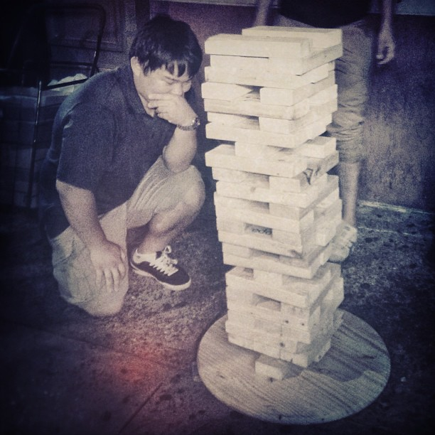 20 seconds later it fell on his head #derp #drunk #jenga #hotmess (at Street Jenga Failure)