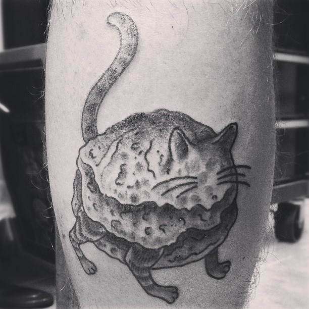 Biscuit. (at Three Kings Tattoo Parlor)