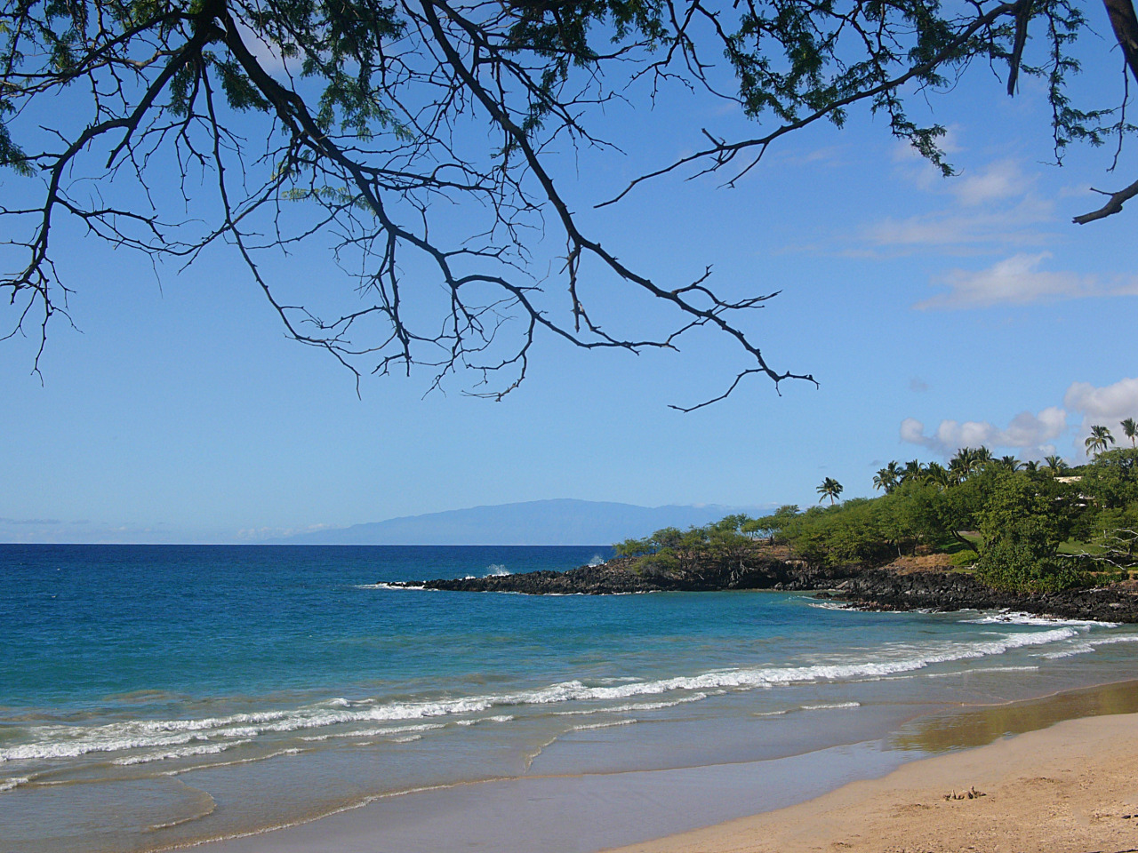 A view from my hammock in a tree at Hapuna Beach, looking northwest to Maui in the distance.