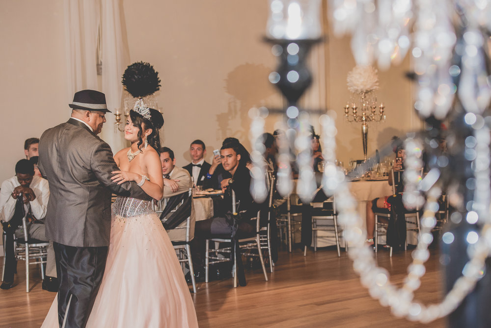 Marisol and her father dancing