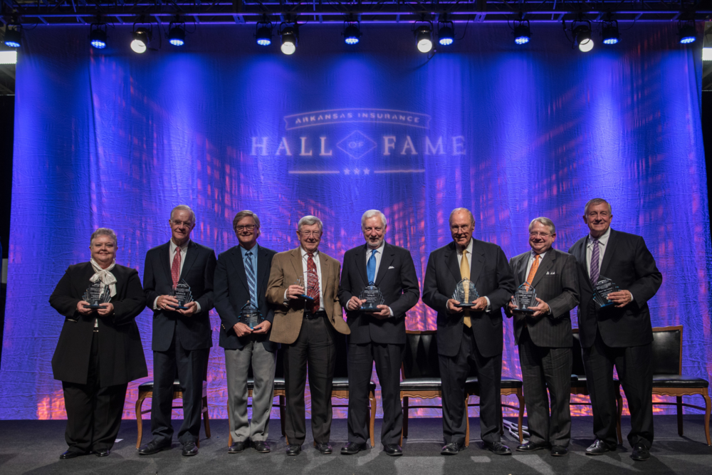 "2015 Arkansas Insurance Hall of Fame Inductees: Lenita Blasingame, Jay Bradford, Dr. Tom Frazier representing George Frazier, Steve Strange, Sr., Tad Krug, Allan Meadors, Greg Feltus representing Robert C ""Bob"" Hickman, and Walter ""Jiggs"" Ramsey"