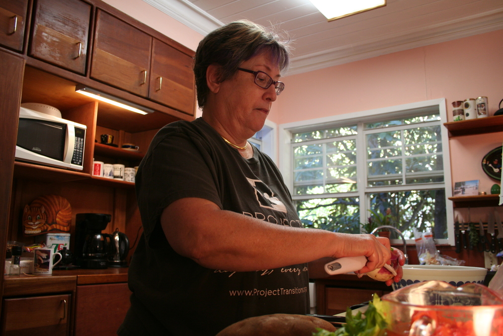 Jane King prepares a meal in her kitchen for Doug's House.