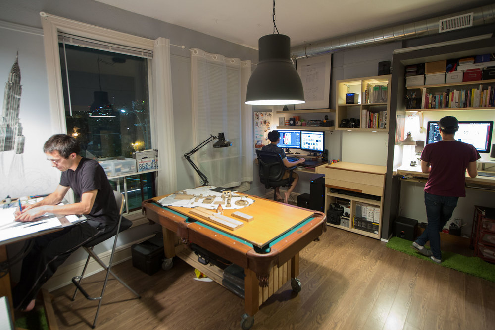 Studio Workspace : shared common space for group work, projects, and play (it's a pool table too). Nam's video-editing studio in the back, and Alex's UX studio on the very right.