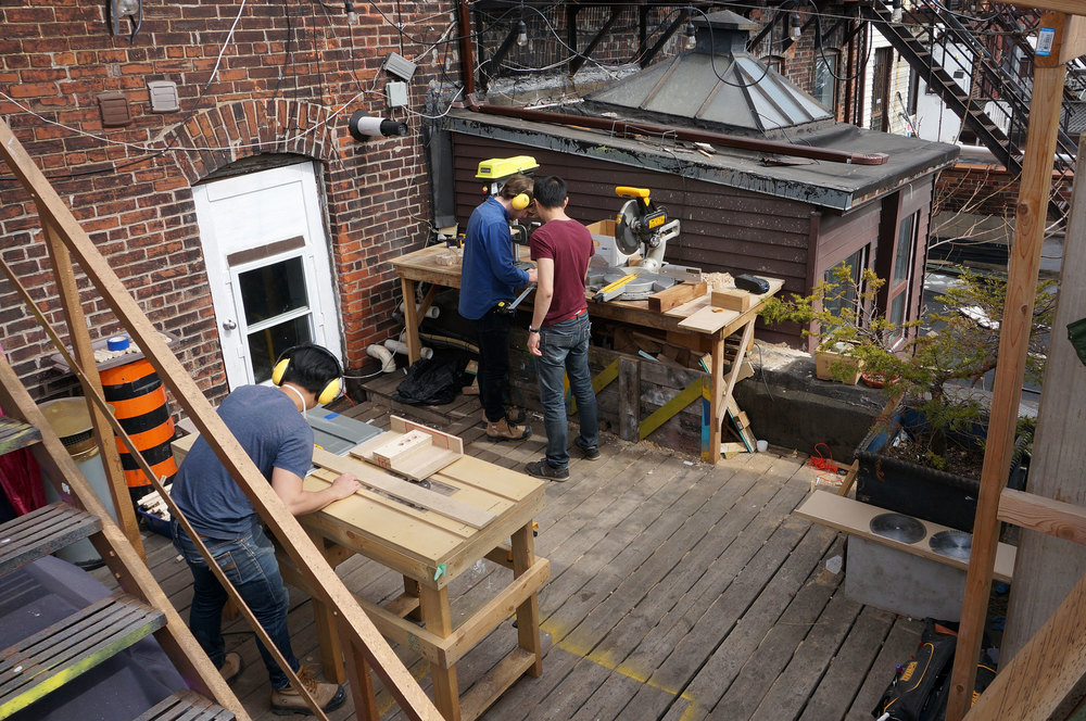 Woodshop/Assembly Space : outdoor studio being used for woodwork, building, and fabrication.
