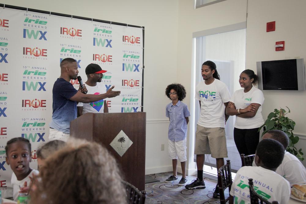 Youth Golf Clinic - Irie & Jamie with mic pointing to Joshua.jpg