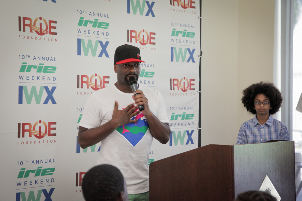 Youth Golf Clinic - Irie Talking Hand on Chest Step & Repeat.jpg